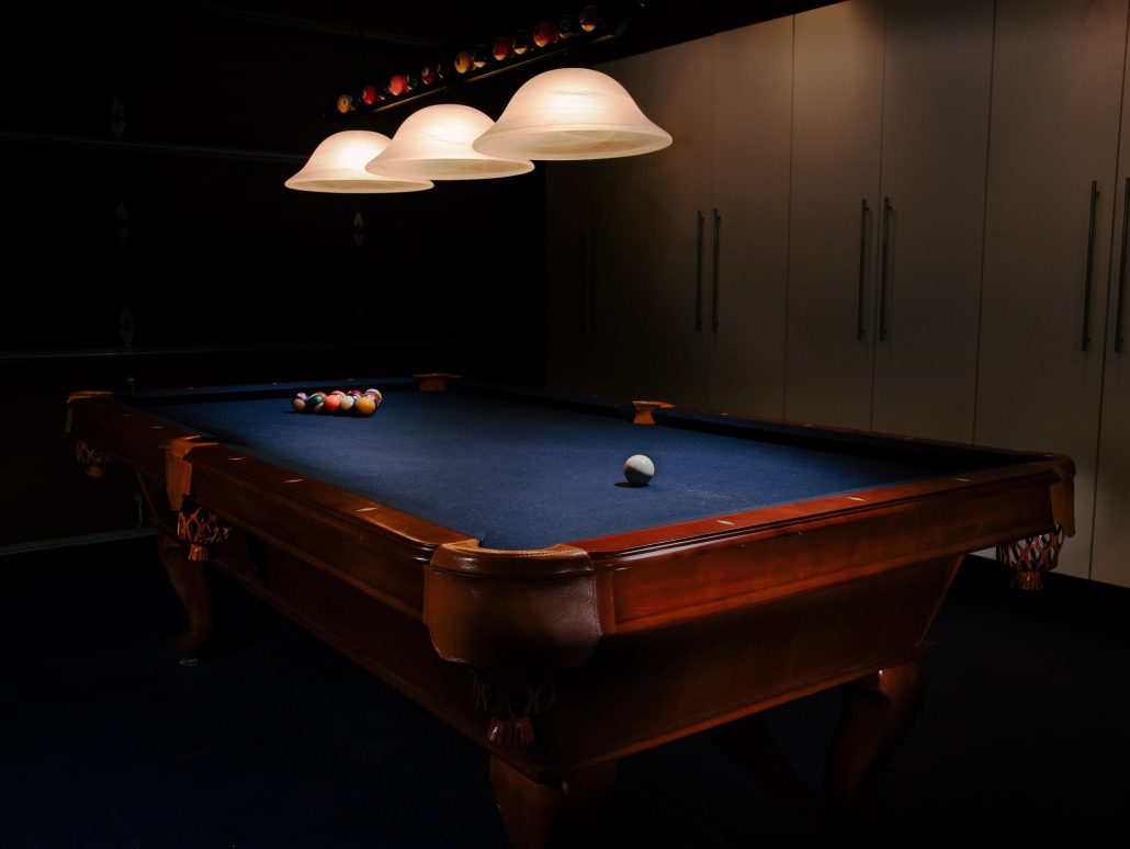 billiard table under dimmed lights