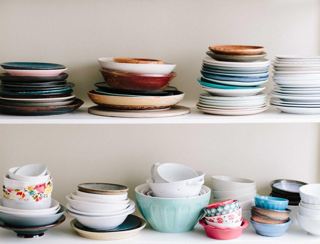 plates on a shelf stacked upward