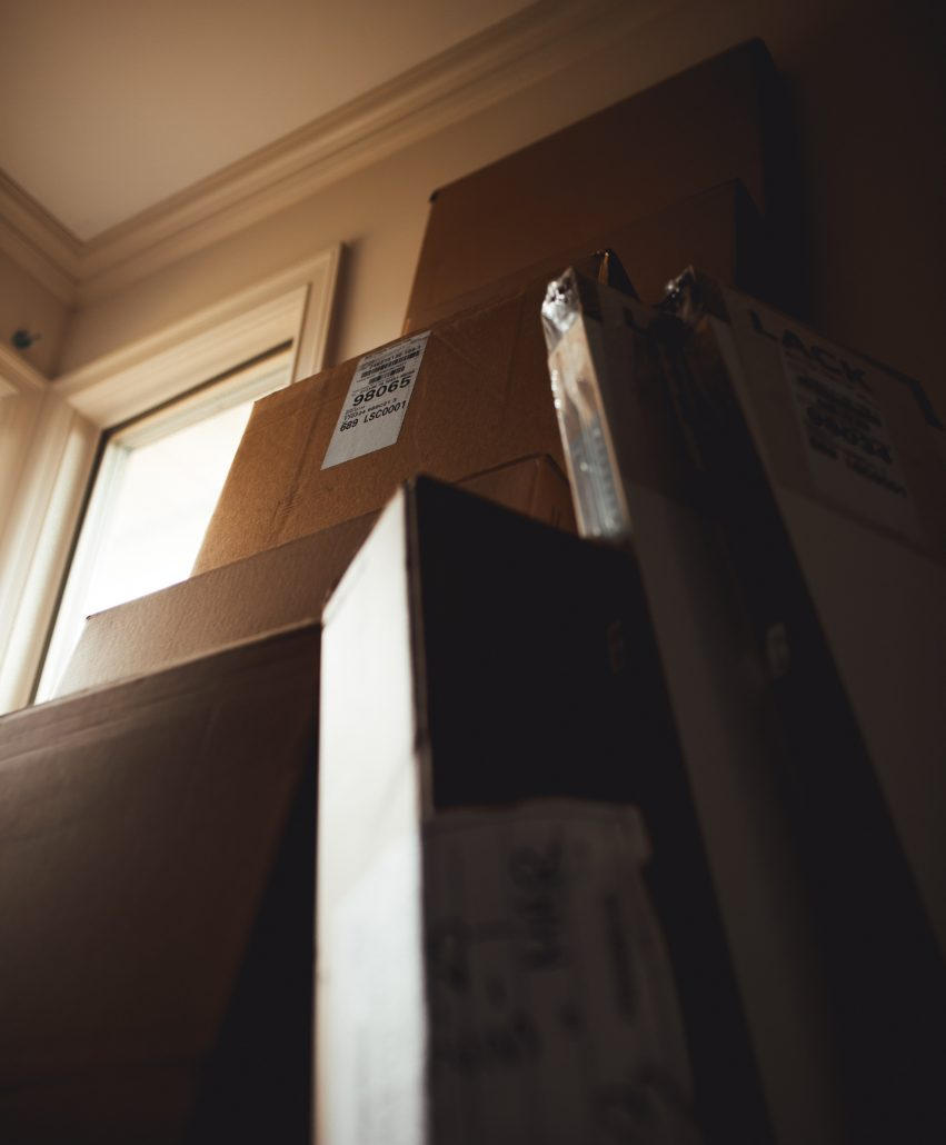 cardboard boxes leaning against a wall