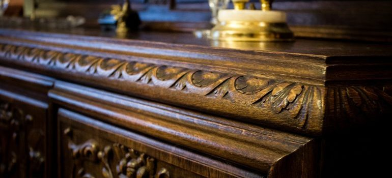 an antique drawer needs furniture movers Chicago for safety