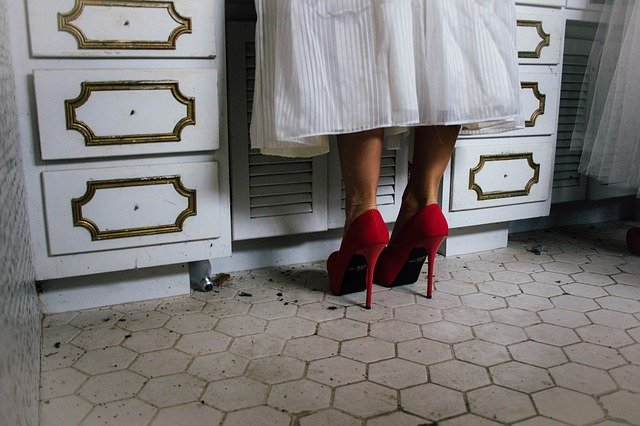 Woman in a kitchen in red heels