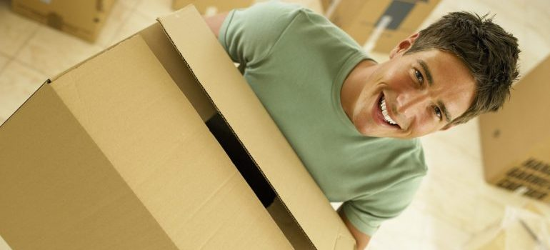 Man holding a moving box