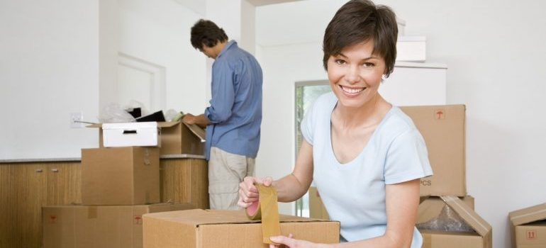 Couple moving furniture - happy