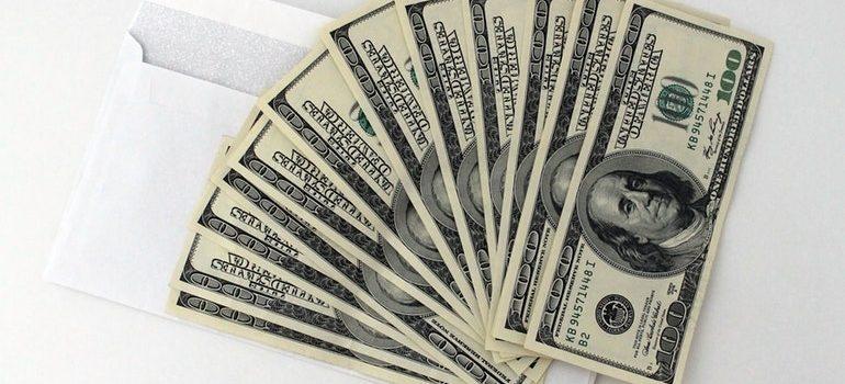 Dollar bills on an envelope.