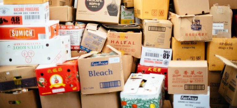 weak cardboard boxes showing the benefits of using plastic moving bins