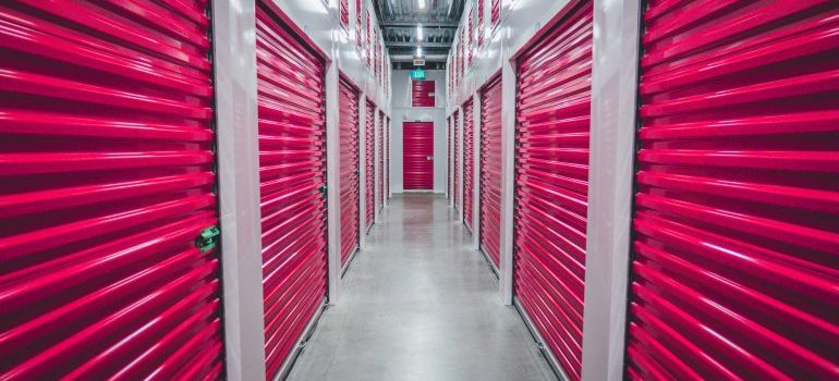 row of storage units with red doors