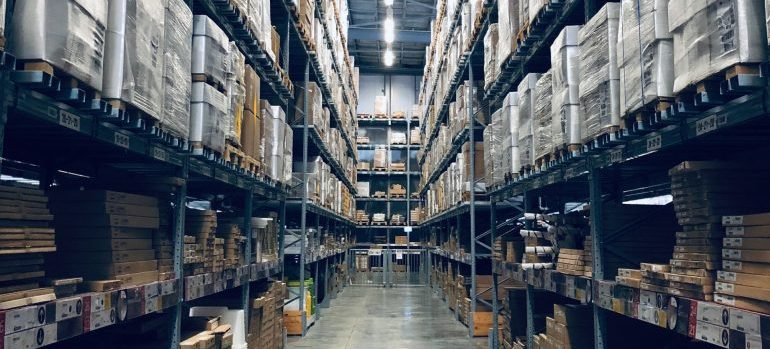 boxes and palettes on high shelves in a warehouse