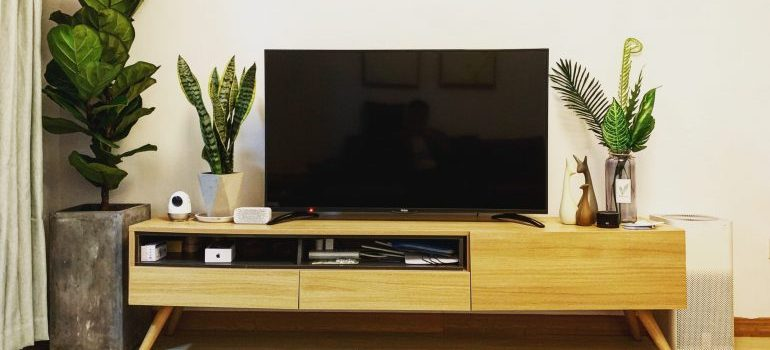 Flat screen TV on a yellow desk