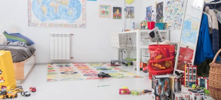 nursery with toys and white walls