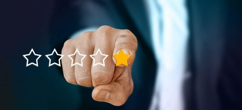 a man pointing at a 1-star review
