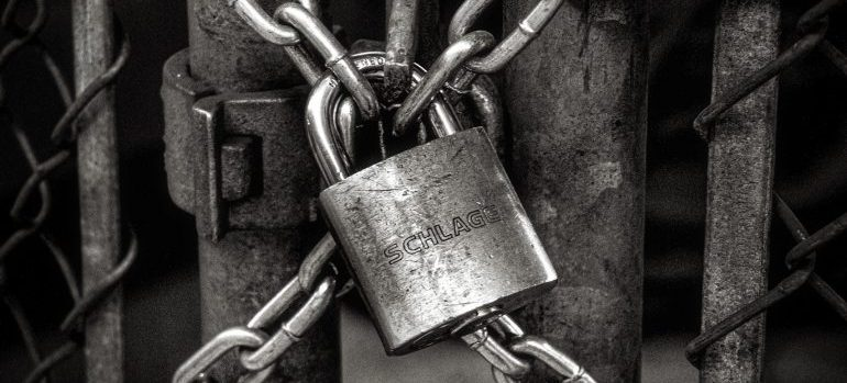 lock and chain on a fence