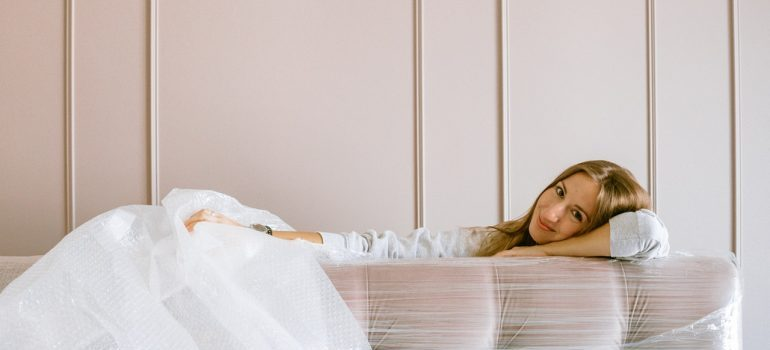 A woman posing with her headboard wrapped.