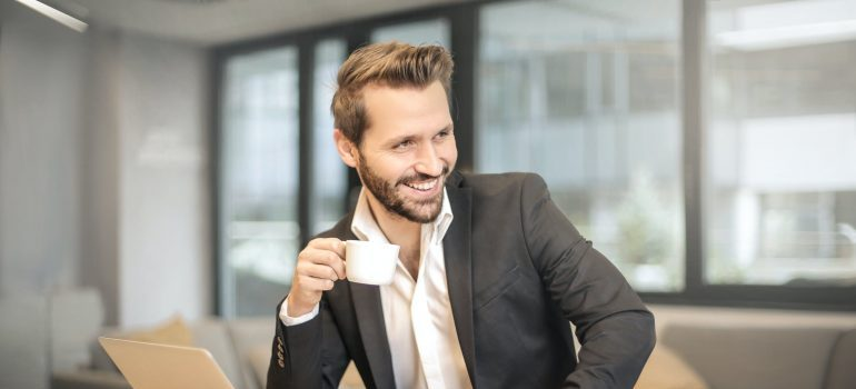 A businessman drinking coffee