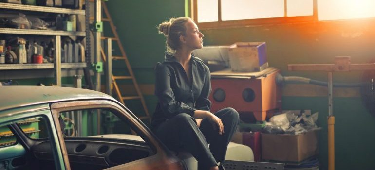 woman sitting in a garage
