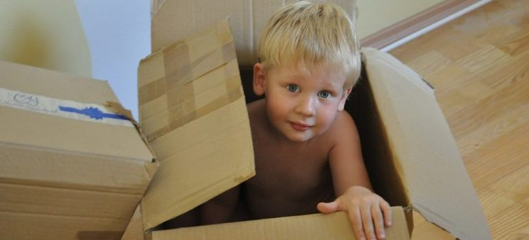 A child hiding in a box