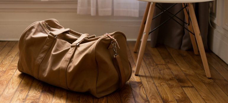 brown duffel bag for storing away sports equipment