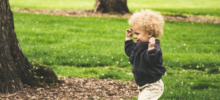 A boy playing in a park