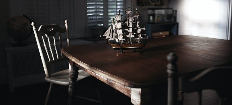 A kitchen table with the ship model on it