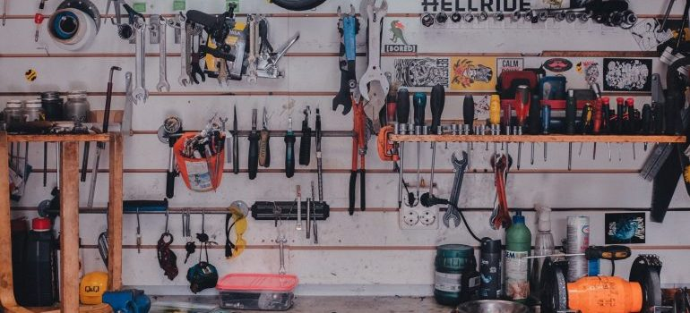 A garage wall filled with tools