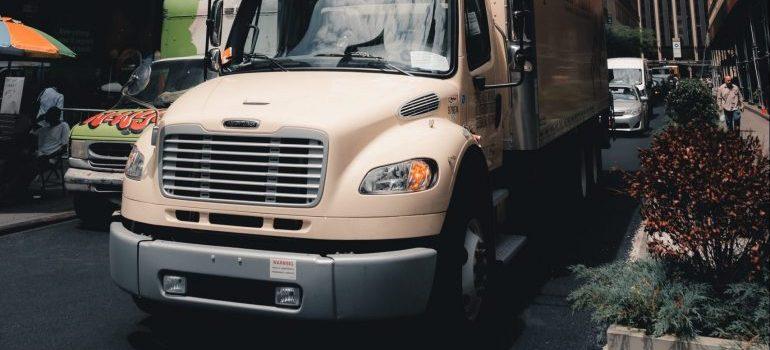 Beige truck parked in the street