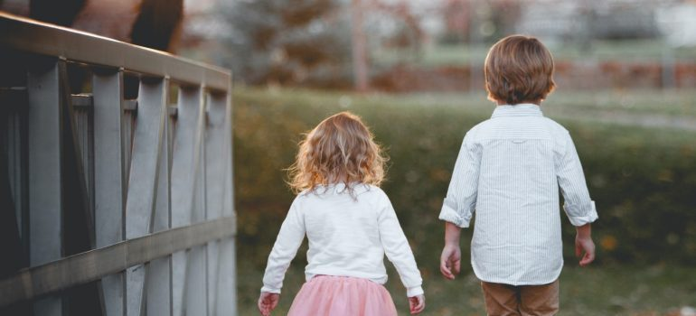 Two kids walking together
