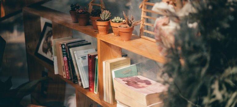 A shelf with books, photos, etc.