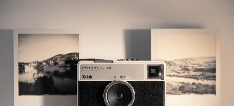 An old camera with old photohraphs