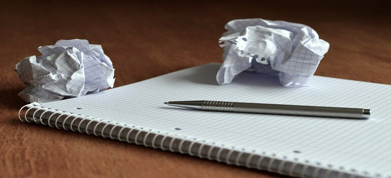 notebook and crumbled paper