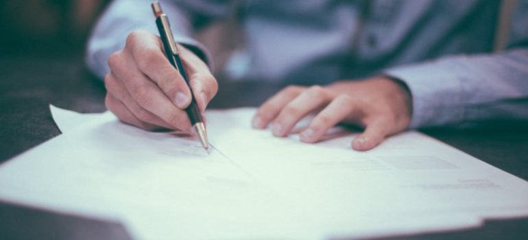 A man signing a contract