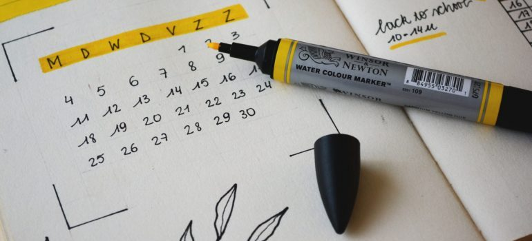 a sharpie marker resting on a calendar