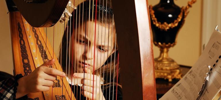 girl playing a harp