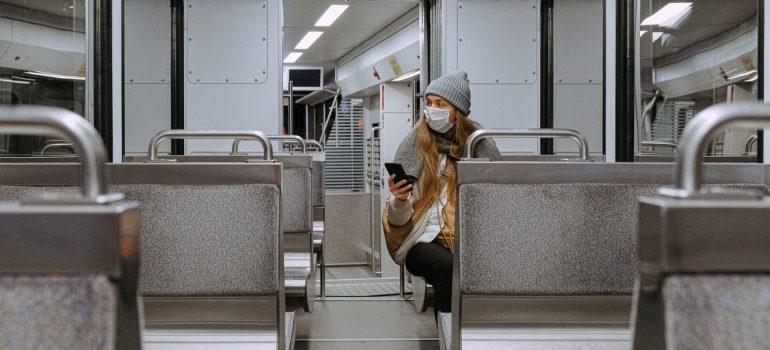 a woman sitting in an empty train wagon