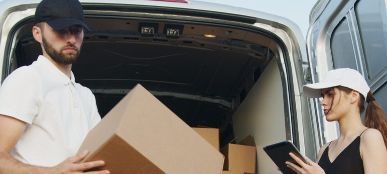 Two movers loading the moving truck