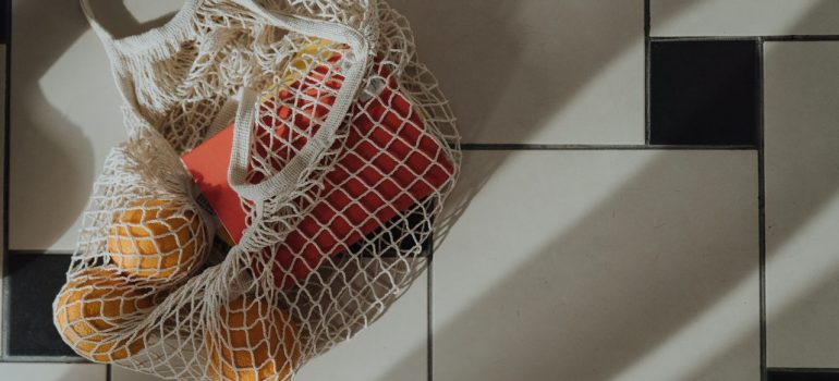 a knitted bag holding fruits as something your movers will refuse to relocate