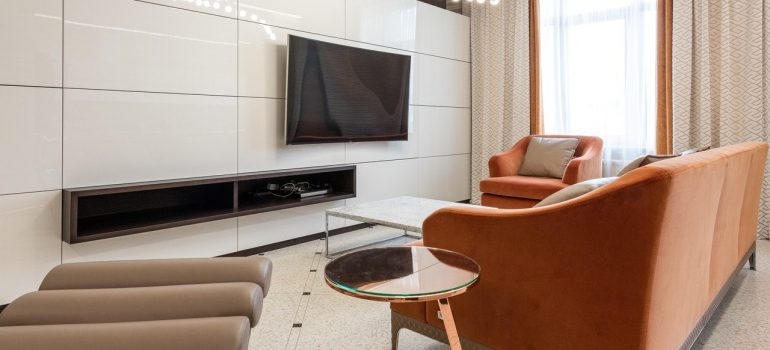 a living room with modern touches and earthly colours
