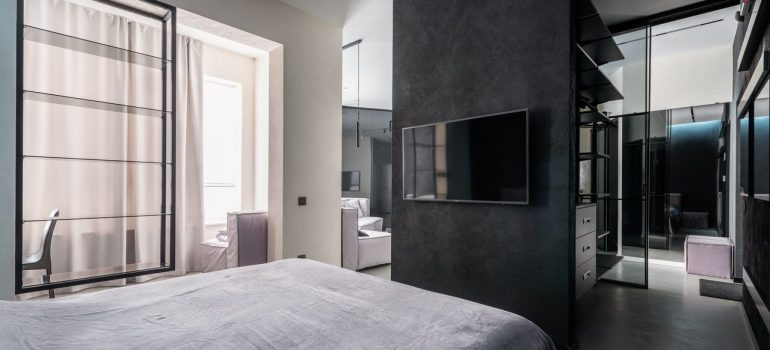 a picture of a modern bedroom with black and white details as one of the virtual staging tips