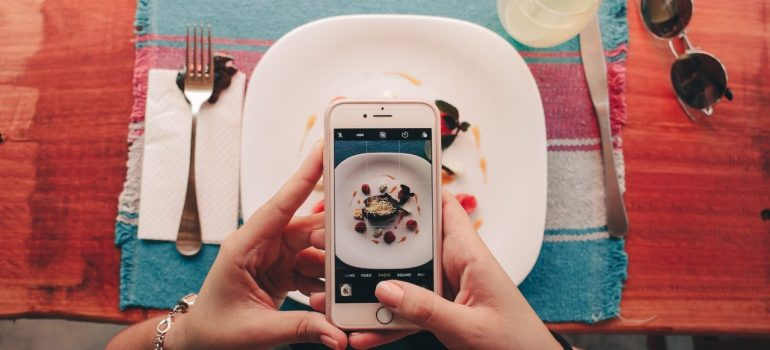 a person taking a picture of their dish