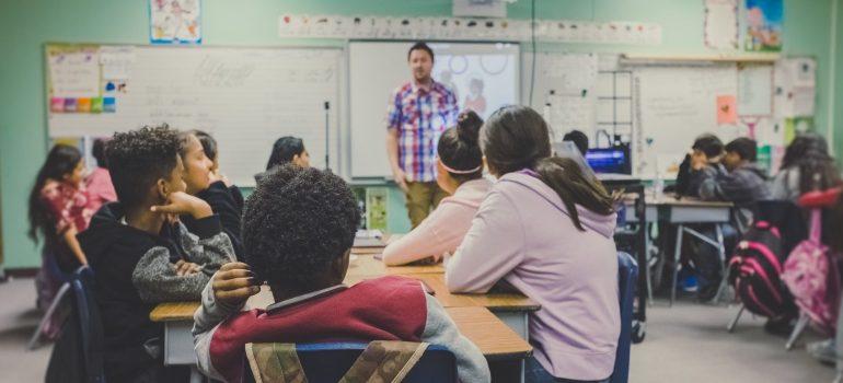 a teacher with children inside a classroom