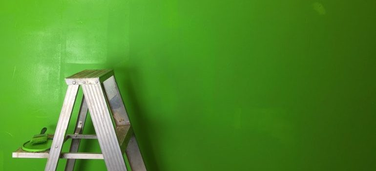 a green wall and a ladder - add value to your home in Niles
