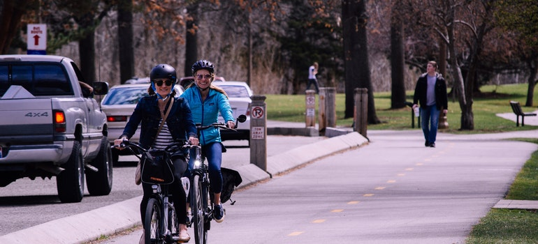 Women enjoying cycling after working in Lincolnwood