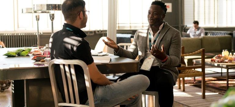 Two men discuss about Skokie vs. Des Plaines